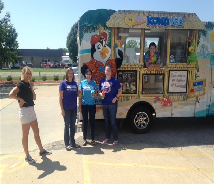 Kona Ice Truck being visited by 4 Insurance Agents