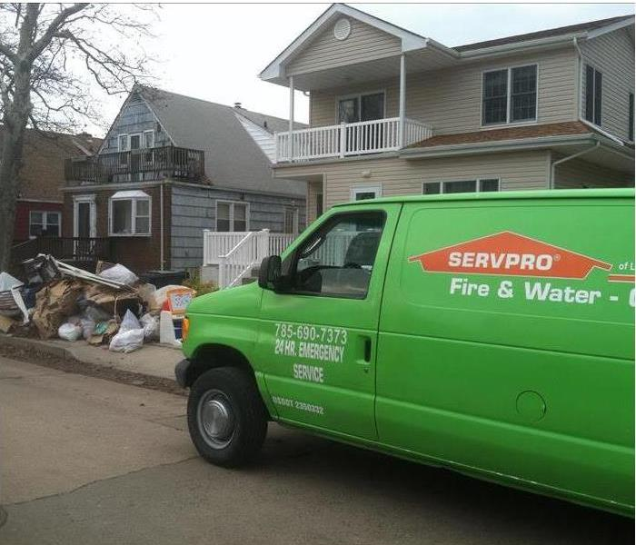 SERVPRO van parked in front of residence affected by storm