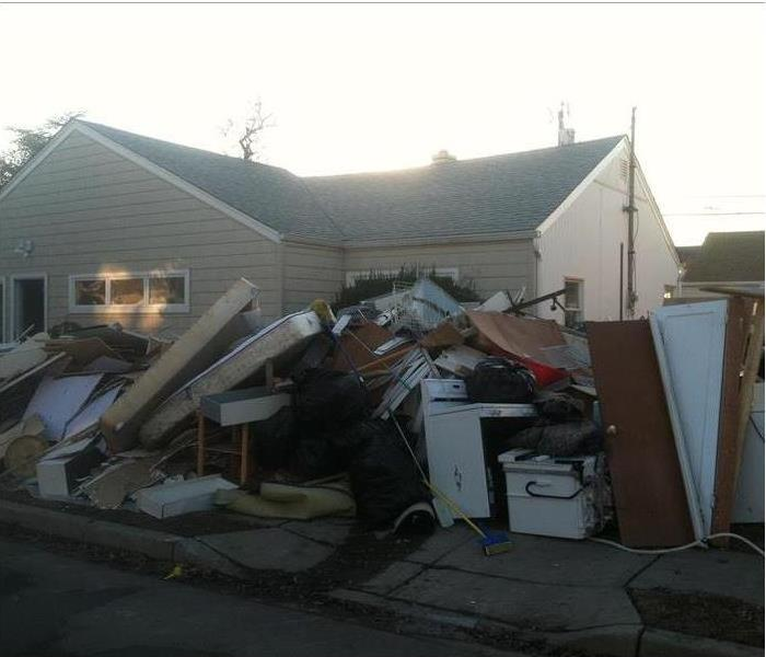Pile of debris taken from homes after being restored