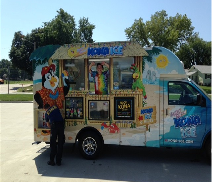 Kona Ice Truck parked in the parking lot of an insurance agency